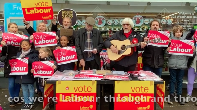 "Singing ""We're all voting Labour"""