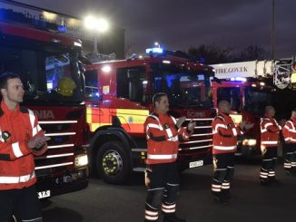 Firefighters clap the NHS