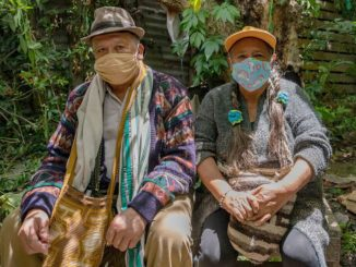 Colombians with coronavirus masks
